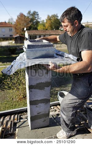 Builder using zinc flashing in the construction of a pillar