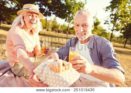 Do You Want Some. Selective Focus On A Friendly Looking Man Smiling While Holding A Chocolate Croiss