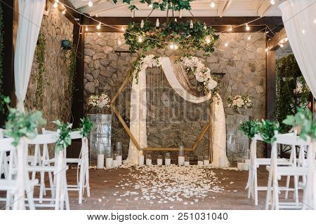 Magnificent Decoration Of A Wedding Ceremony With Original Details And Candles. Festive Sparks And G