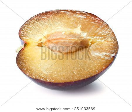 Close-up View Of Half Of A Plum Isolated On White Background