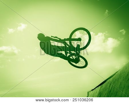 The Guy Does Tricks On A Bicycle. Green Tinting.