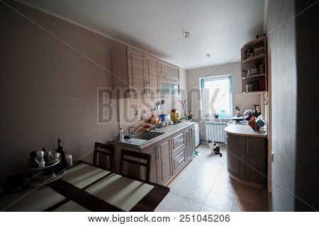 Kitchen Interier. Kitchen With Cupboards, Tables In Gray Tones. Unfinished Repairs In The Kitchen. C