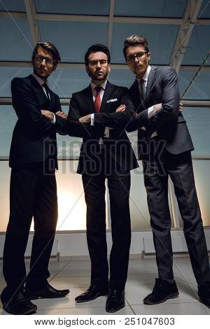 in full growth.three confident businessmen look forward