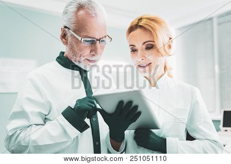 Results Of Research. Two Successful Smart Scientists Feeling Very Busy While Checking The Results Of