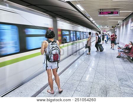 Tourists Waiting For A Train In A Athens Metro Station.