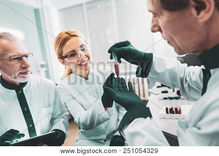 Green Gloves. Experienced Biologists Wearing Green Gloves Feeling Busy While Working In Research Roo