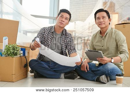 Ambitious Mature Vietnamese Coworkers Dreaming About Office Repairs