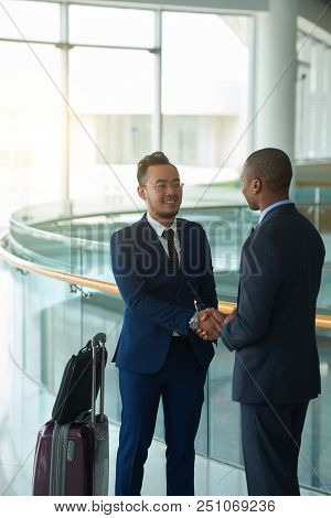 Entrepreneurs Meeting His Foreign Business Partner In Airport Terminal