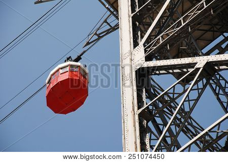 BARCELONA, SPAIN - APRIL 19, 2018: A vintage red cable car on the Transbordador Aeri del Port docks at the Torre de San Sebastia station. The attraction first opened in 1929.