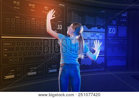 Personal Profile. Calm Attentive Long Haired Girl Carefully Touching The Icon On A Transparent Scree