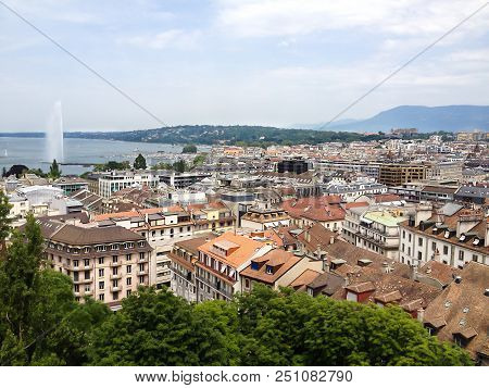 Top View Of Geneva Old Town And Lake Geneva With Jet D'eau Fountain As Symbol Of Geneva City, Switze