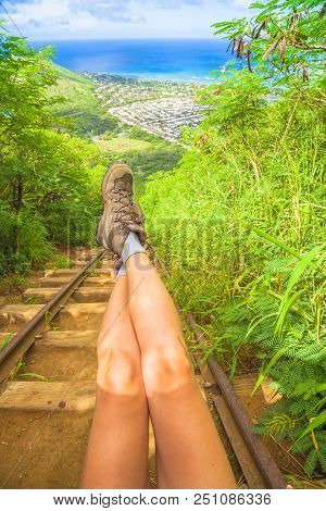 Details Of Woman Legs With Hiking Boots On Stairway Of Popular Hawaiian Hiking, Koko Head Stairs Hik