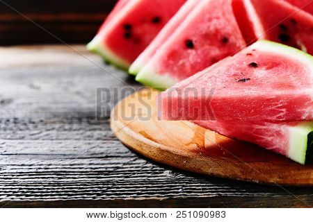 Red Watermelon On Wooden Table Background With Copyspace