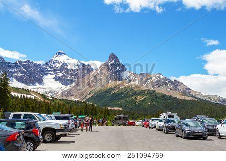 Jasper, Canada - Jul 8, 2018: Visitors Stop At The Parker Ridge Hiking Trailhead Parking Lot On The