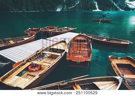 Traditional Wooden Rowing Boats On Italian Alpine Braies Lake At Summer. Lago Di Braies Is Largest N