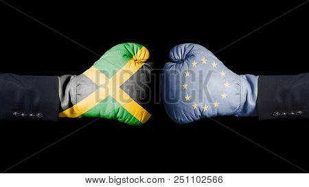 Male Hand In Boxing Gloves With Jamaica And European Union Flags. Jamaica Versus European Union Conc