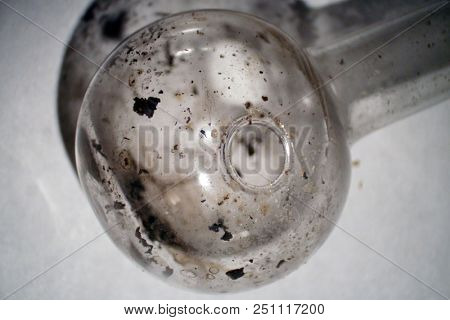 Microscopic Close Up of a Used Methamphetamine Glass Pipe used for Smoking Crystal Meth. Found on a sidewalk. Meth Residue still inside. Drug Abuse.