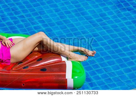Aerial View Of Female In Bikini Lying On A Floating Mattress In Swimming Pool, Inflatable Mattress W