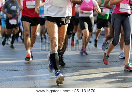 Marathon Running Race. Legs And Bodies Only. Unrecognizable People. The Marathon Is A Long-distance