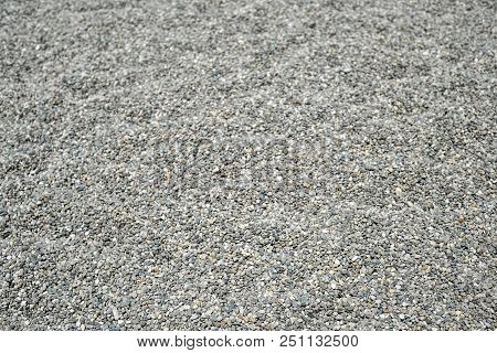 Background With Small Grey Shingle On The Beach In Natural Shades. Pebble Background Close Up. Natur