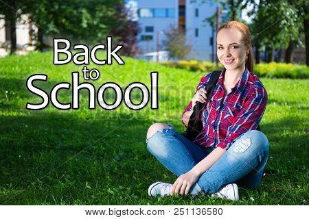 Back To School - Teenage Student Girl With Backpack Sitting In Summer Park