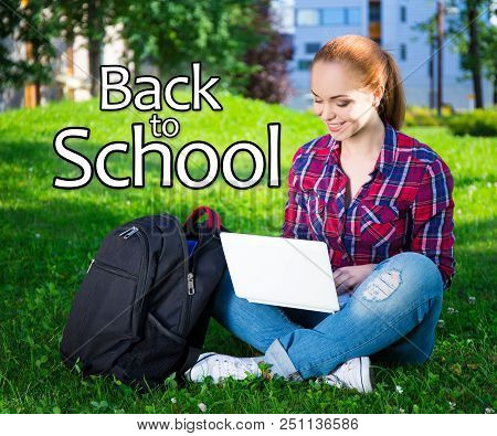 Back To School - Teenage Student Or School Girl Sitting With Laptop In Summer Park
