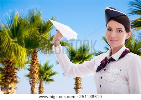 Vacation And Travel Concept - Stewardess With Paper Plane Over Summer Background With Palm Tree