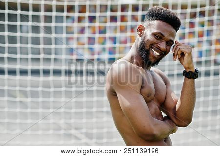 Handsome Sexy African American Muscular Bare Torso Man At Jeans Overalls Posed At Green Grass Agasin