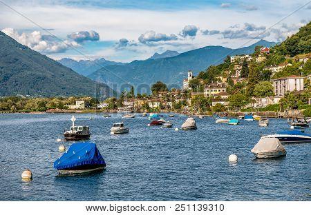 View of Magadino village from beach of Vira village fraction of Gambarogno, Ticino, Switzerland poster
