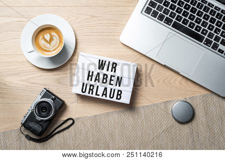 Wir Haben Urlaub Written In German On Light Box Meaning Closed For Holidays As Flatlay From Above Of