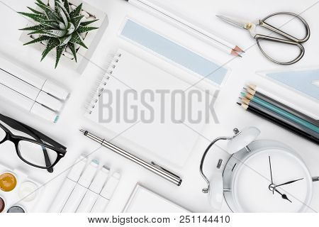 White Tabletop With Office Supplies And Blank Notebook In Center