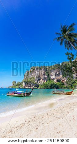 Amzing Landscape With Traditional Longtail Boats, Rocks, Cliffs, Beautiful Sea Tropical And White To