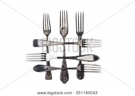 Collection Of Antique Forks Over White Background