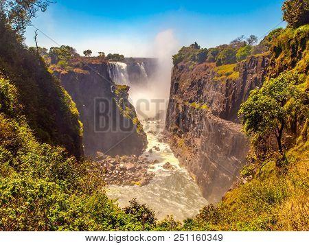 Victoria Falls On Zambezi River. Dry Season. Border Between Zimbabwe And Zambia, Africa.