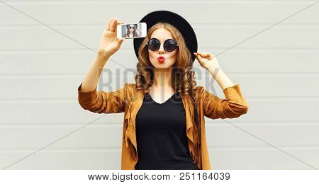 Cool Girl Model Taking Photo Picture Self-portrait On Smartphone Wearing Retro Elegant Hat, Sunglass