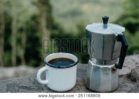Coffee The Outdoors. Adventure, Travel, Tourism And Camping Concept. Hiker Drinking Tea From Mug At
