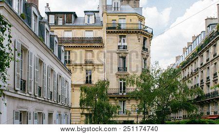 Traditional Luxury Paris Apartment Building - Vintage Windows, Mansardes And Rooftops - Elevated Vie