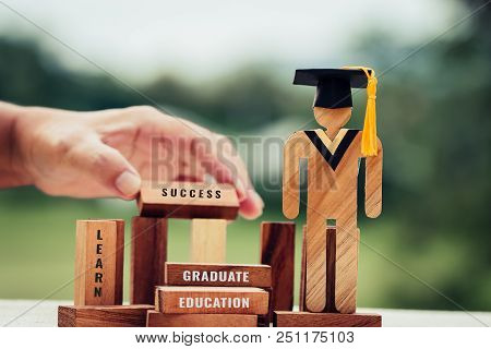 Back to School Concept, People Sign wood with Graduation celebrating cap on wooden square blocks tower blur hands. Blank space for letter e.g education, graduate. Ideas for international Educational poster