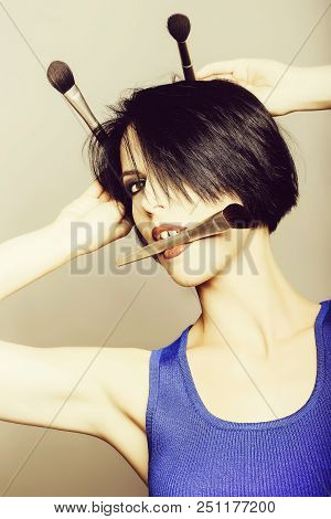 Pretty Girl With Dark Short Hair Red Lips And Sexy Make Up In Blue Dress Has Fun With Make Up Brushe