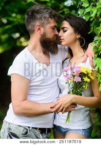 Man Bearded Hipster Hugs Gorgeous Girlfriend. Couple Love Romantic Date Nature Park Background. Love