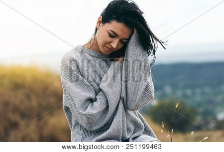 Smiling Dream Female With Closed Eyes With Hand On Blowing Hair. Portrait Of Attractive Brunette Cau