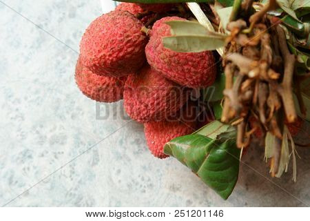 A Bunch Of Red Lychees On A Plate, Selective Focus.