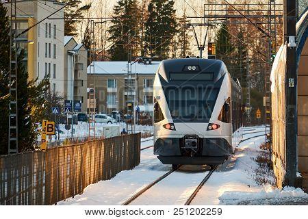 Fast Passenger Commuter Train Arriving At Station