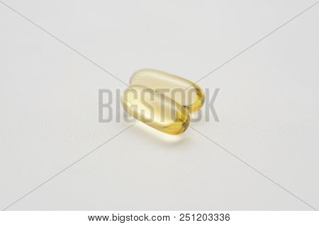 gelatine capsules of omega 3 fish oil on white background