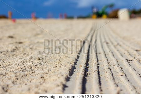 Traces Of Tire On Sand And Work With Scraper