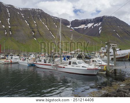 Iceland, West Fjords, Isafjordur, June 25, 2018: Summer View On Isafjordur Harbor With Fishing Boats