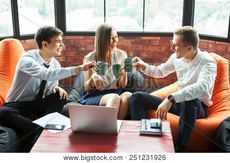 Group Of Business People Having Fun In An Informal Atmosphere.