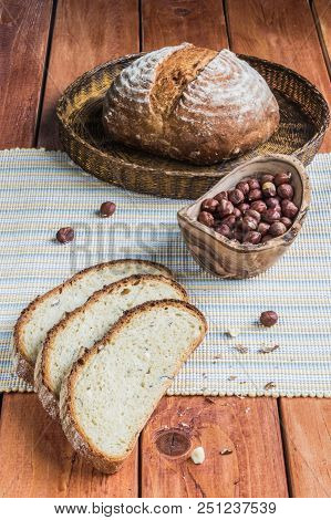 Kamut And Hazelnuts Bread On A Wooden Table Board