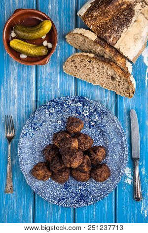 Traditional Meat Balls Served With Bread And Pickles