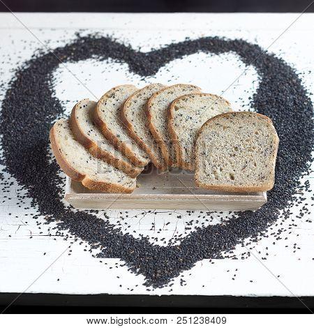 Poppy Seeds Sourdough Bread On A White Table Board